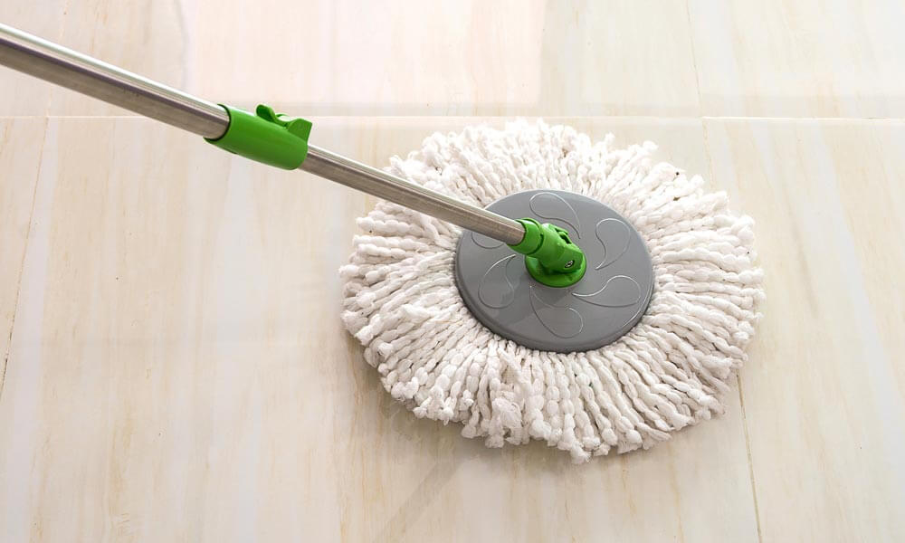 cleaning floor with white fabric